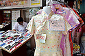 July 24, 2011 - Yokohama, Japan - Authentic Chinese dresses are shown on display for sale in Yokohama's Chinatown District. Yokohama Chinatown is a largest Chinatown in Asia with a history that dates back to approximately 150 years. Until today, it still remains as a popular tourist destination for locals and travelers abroad. (Photo by Yumeto Yamazaki/AFLO)