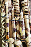 Ocelot fur and snake skin decorates bow and arrow quivers made by indigienous hunters, Peru