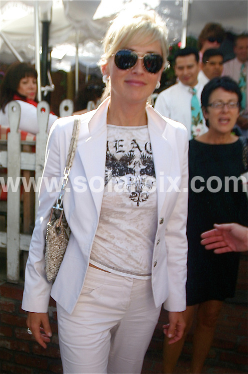 **ALL ROUND PICTURES FROM SOLARPIX.COM**.**WORLDWIDE SYNDICATION RIGHTS EXCEPT FOR USA, AUSTRALIA & GERMANY**.American actress, Sharon Stone was spotted dressed head to toe in white, leaving the Ivy restaurant in West Hollywood, California, USA. 17th September 2008..JOB REF: 7379 LAS       DATE: 17_09_2008.**MUST CREDIT SOLARPIX.COM OR DOUBLE FEE WILL BE CHARGED* *UNDER NO CIRCUMSTANCES IS THIS IMAGE TO BE REPRODUCED FOR ANY ONLINE EDITION WITHOUT PRIOR PERMISSION*