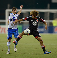 Nick DeLeon (18) of D.C. United keeps the ball away from Sinisa Ubiparipovic (28) of the Montreal Impact during the game at RFK Stadium in Washington DC.   D.C. United defeated the Montreal Impact, 3-0.