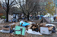 November 23, 2011, Toronto Police and city workers arrived in significant numbers early this morning, beginning the process of tearing down the Occupy Toronto tent camp at St. James Park, an onerous task given the amount of garbage as seen here.