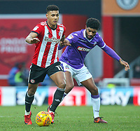 Brentford's Ollie Watkins gets away from Bolton Wanderers' Mark Little<br /> <br /> Photographer Alex Dodd/CameraSport<br /> <br /> The EFL Sky Bet Championship - Brentford v Bolton Wanderers - Saturday 13th January 2018 - Griffin Park - Brentford<br /> <br /> World Copyright &copy; 2018 CameraSport. All rights reserved. 43 Linden Ave. Countesthorpe. Leicester. England. LE8 5PG - Tel: +44 (0) 116 277 4147 - admin@camerasport.com - www.camerasport.com
