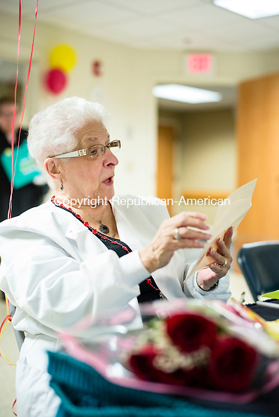 Waterbury, CT- 11 November 2016-111116CM07-  Margaret Baren, medical records director, opens a gift at Cheshire House Nursing and Rehabilitation Center in Waterbury on Friday.  Baren, who turns 90 on Monday, celebrated her birthday with co-workers, who presented her with gifts, flowers and cake.    Christopher Massa Republican-American