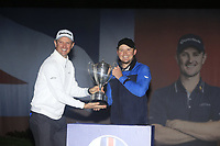 Justin Rose (ENG) presents the Trophy to Eddie Pepperell (ENG) for winning the Sky Sports British Masters at Walton Heath Golf Club in Tadworth, Surrey, England on Sunday 14th Oct 2018.<br /> Picture:  Thos Caffrey | Golffile<br /> <br /> All photo usage must carry mandatory copyright credit (&copy; Golffile | Thos Caffrey)