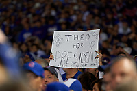 Chicago Cubs fan holds a sign for Theo Epstein before Game 3 of the Major League Baseball World Series against the Cleveland Indians on October 28, 2016 at Wrigley Field in Chicago, Illinois.  (Mike Janes/Four Seam Images)
