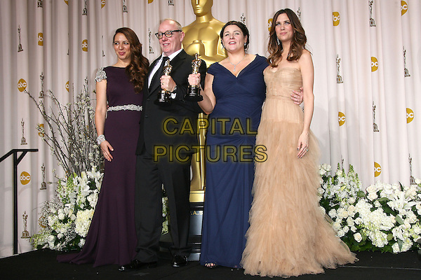 Maya Rudolph, Oorlagh George, Terry George, Kristen Wiig.84th Annual Academy Awards held at the Hollywood & Highland Center, Hollywood, California, USA..February 26th, 2012.oscars full length black suit award trophy  winner trophies winners pink blue dress purple .CAP/ADM.©AdMedia/Capital Pictures.