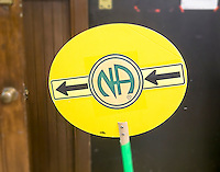 A sign directs former addicts to a Narcotics Anonymous meeting in the Brownsville neighborhood of Brooklyn in New York on Saturday, May 7, 2016.  (© Richard B. Levine)