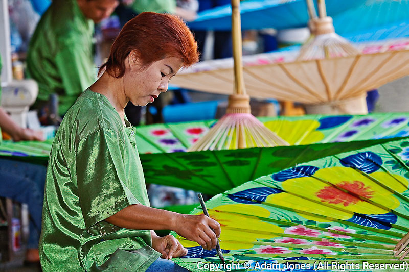 Artist painting hand made decorative umbrella, Bo Sang, near Chiang Mai,.Thailand