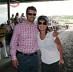 Former Governor of Alaska Sarah Palin (R) and husband Todd in the paddock to see First Dude run in the 142nd  Belmont Stakes Day  at Belmont Park Racetrack, Elmont, New York.