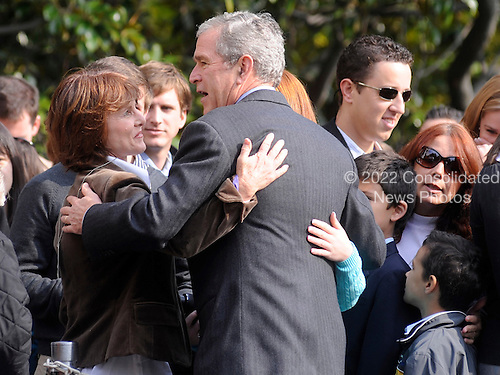 Washington, DC - November 2, 2008 -- United States President George W. Bush greets supporters as he arrives on the South Lawn of the White House in Washington after a weekend trip to the Presidential Retreat in Camp David, Maryland on Sunday, November 2, 2008.  .Credit: Kevin Dietsch / Pool via CNP