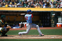 """OAKLAND, CA - AUGUST 26:  Robinson Chirinos #61 of the Texas Rangers bats against the Oakland Athletics during the game at the Oakland Coliseum on Saturday, August 26, 2017 in Oakland, California. Note: both teams are wearing special colorful uniforms for """"Players Weekend"""" that also include nicknames on the backs of their jerseys. (Photo by Brad Mangin)"""