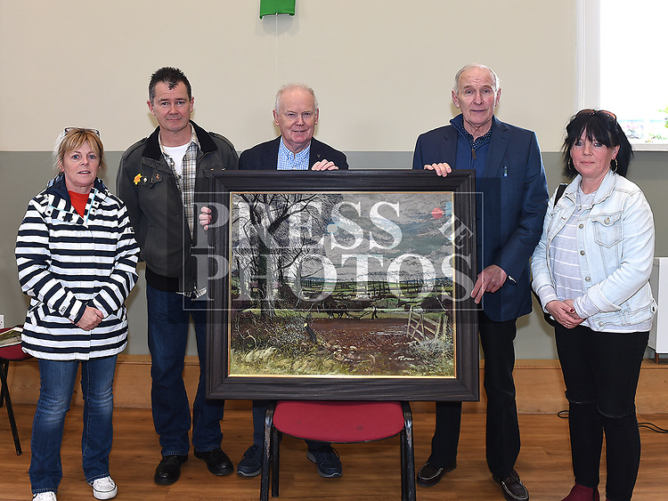 Shane Connaughton presents a copy of a painting by local artist Simon Coleman to Noel Heeney Chairperson and members of the Coleman family, Joe Coleman, Yvonne Coleman and Anne Hamilton. Photo:Colin Bell/pressphotos.ie