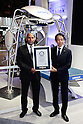 Kiichiro Miyata (R) Managing Executive Officer and CTO of Omron Corporation receives a Guinness World Record certificate for the robot FORPHEUS during the CEATEC Japan exhibition on October 3, 2016, Tokyo, Japan. The robot was earlier certificated by Guinness World Records as the first robot table tennis tutor. CEATEC Japan is a cutting-edge IT and electronics exhibition. This year there are 648 companies and organisations taking part from 24 different countries and the show is open to the public from October 4 to 7. (Photo by Rodrigo Reyes Marin/AFLO)