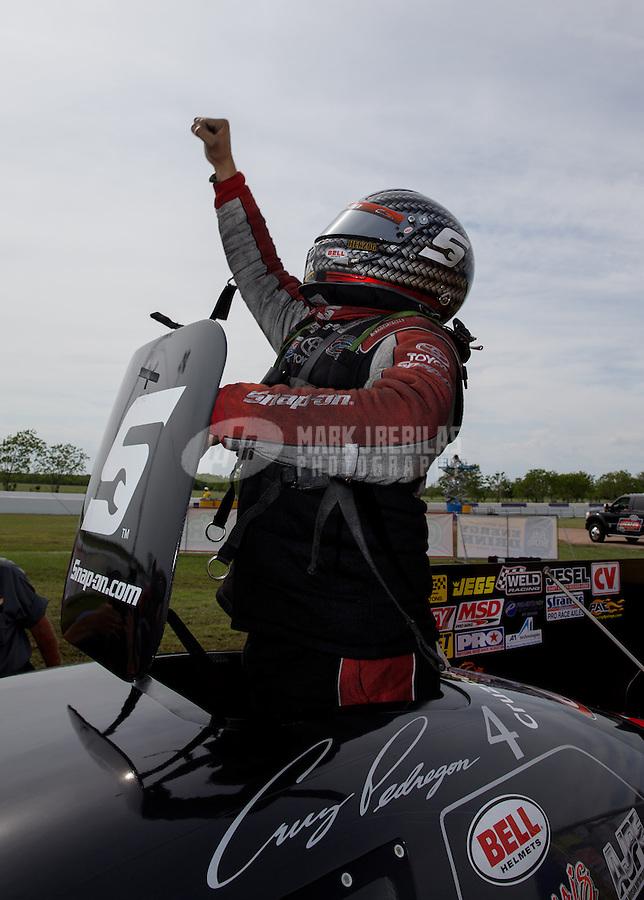 Apr. 28, 2013; Baytown, TX, USA: NHRA funny car driver Cruz Pedregon celebrates after winning the Spring Nationals at Royal Purple Raceway. Mandatory Credit: Mark J. Rebilas-