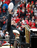 Ohio State Buckeyes tight end Jeff Heuerman hoists the Amway Coaches Trophy during the celebration for winning the national championship at Ohio Stadium on Jan. 24, 2015. (Adam Cairns / The Columbus Dispatch)