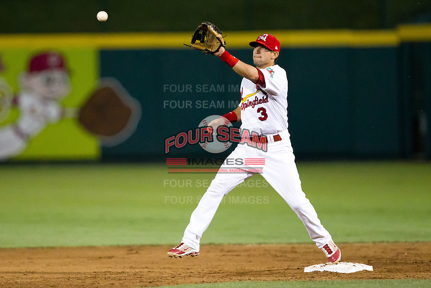 Jose Garcia (3) of the Springfield Cardinals keeps a toe on second while catching a ball thrown for the out during a game against the Tulsa Drillers at Hammons Field on July 20, 2011 in Springfield, Missouri. Springfield defeated Tulsa 12-1. (David Welker / Four Seam Images)