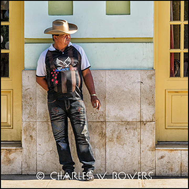 Faces Of Cuba - guys hang out on the street. Is he from Texas?<br /> <br /> - Limited edition of 50 prints.