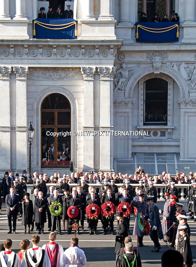 """PRINCE WILLIAM LAYS A WREATH WATCHED BY WIFE CATHERINE, DUCHESS OF CAMBRIDGE.Kate's attended her 1st Remembrance Service with members of the Royal Family at the Cenotaph, London_13th November 2011.©FRANCIS DIAS - NEWSPIX INTERNATIONAL..Mandatory credit photo:NEWSPIX INTERNATIONAL(Failure to credit will incur a surcharge of 100% of reproduction fees)..**ALL FEES PAYABLE TO: """"NEWSPIX  INTERNATIONAL""""**..Newspix International, 31 Chinnery Hill, Bishop's Stortford, ENGLAND CM23 3PS.Tel:+441279 324672.Fax: +441279656877.Mobile:  07775681153.e-mail: info@newspixinternational.co.uk"""