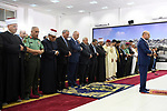Palestinian President Mahmoud Abbas and his Prime Minister Rami Hamdallah perform Eid al-Fitr prayers, in the West Bank city of Ramallah on June 25, 2017. Photo by Thaer Ganaim