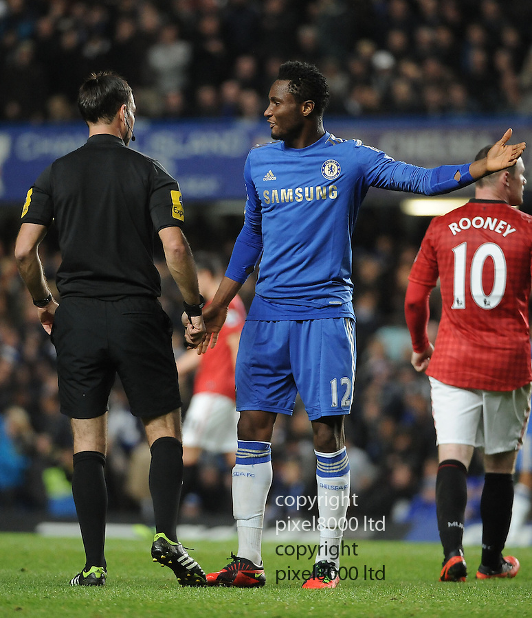 Mark Clattenburg makes an inappropriate remark to John Obi Mikel of Chelsea as complains about Fernando Torres's red card during the Barclays Premier League match between Manchester United and Chelsea at Stamford Bridge on Sunday 28 October, 2012 in London, England. Picture Zed Jameson/pixel 8000 ltd.