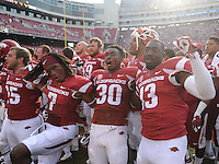 NWA Democrat-Gazette/ANDY SHUPE<br /> Arkansas' Davyon McKinney (13), Kevin Richardson II (30) and Damon Mitchell (7) celebrate their win over University of Texas at El Paso Saturday, Sept. 5, 2015, in Razorback Stadium in Fayetteville. Visit nwadg.com/photos to see more from the game.