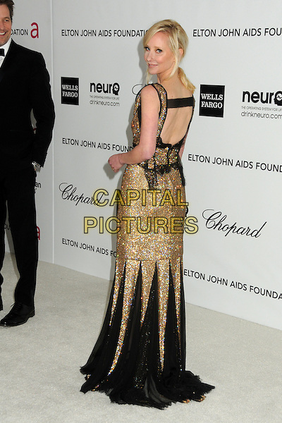 Anne Heche.20th Annual Elton John Academy Awards Viewing Party held at West Hollywood Park, West Hollywood, California, USA..February 26th, 2012.full length black gold dress lace beads beaded back behind rear looking over shoulder oscars.CAP/ADM/BP.©Byron Purvis/AdMedia/Capital Pictures.
