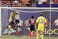 The MetroStars' goalkeeper Jonny Walker punches a ball clear as  the Crew's Edson Buddle goes up for a header. The MetroStars and the Columbus Crew played to a 1-1 tie at Giant's Stadium, East Rutherford, NJ on Sunday August 29, 2004.