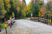 Elbow Pond Road in Woodstock, New Hampshire during the autumn months. This road is closed during the winter months.