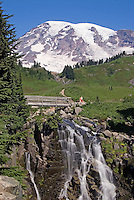Standing by Myrtle Falls footbridge on the Skyline Trail, 2 small girls pause to regard the 14,410 foot high volcano. Along Edith Creek, Mount Rainier National Park, Washington State.....Photographed on digital media.