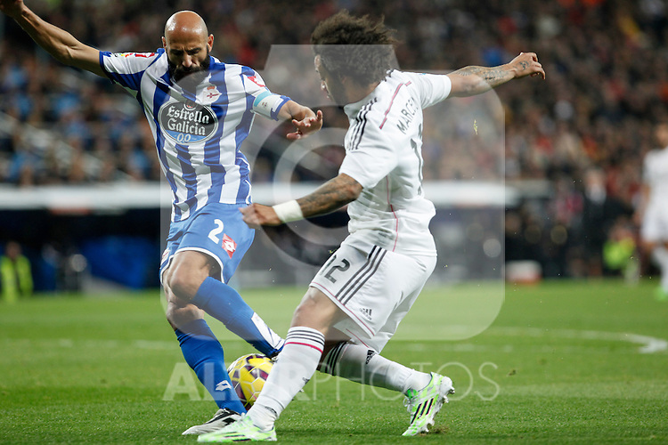 Real Madrid´s Marcelo Vieira (R) and Deportivo de la Coruna´s Manuel Pablo during La Liga match at Santiago Bernabeu stadium in Madrid, Spain. February 14, 2015. (ALTERPHOTOS/Victor Blanco)