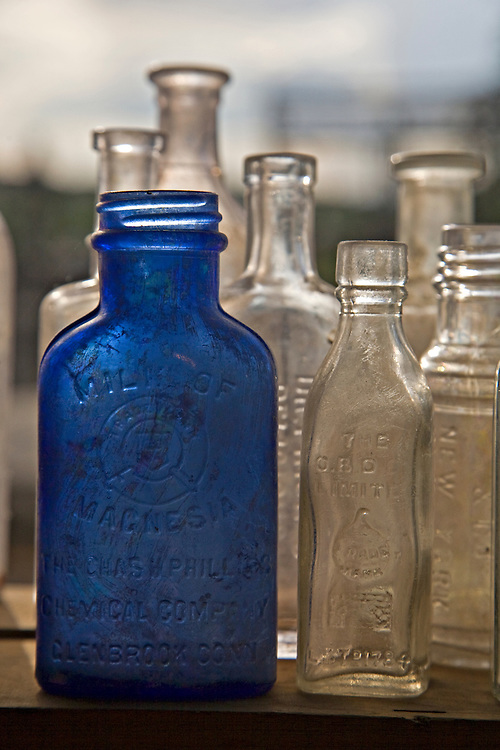 Old empty bottles at the Cerrillos Turquoise Mining Museum in Los Cerrillos, New Mexico