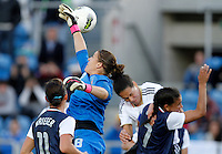 USA's Nicole Barnhart fights for the ball with Germany's during their Algarve Women's Cup soccer match at Algarve stadium in Faro, March 13, 2013.  .