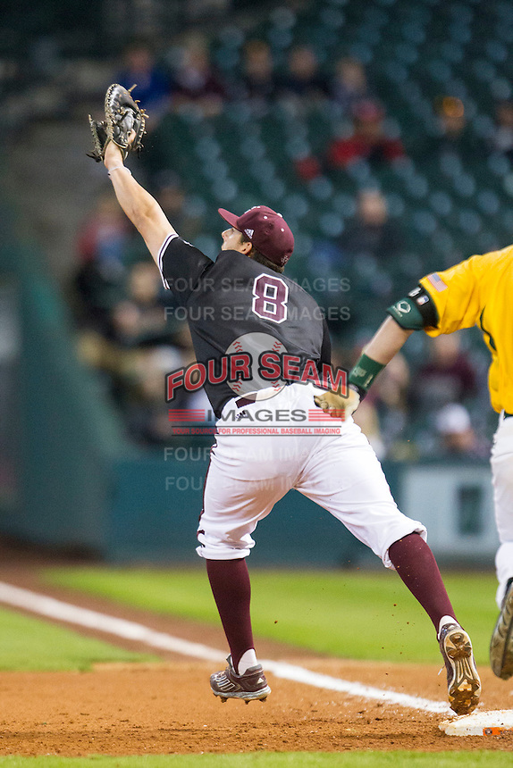 Texas A&M Aggies first baseman Logan Nottebrok (8) stretches to catch a throw during the Houston College Classic against the Baylor Bears on March 8, 2015 at Minute Maid Park in Houston, Texas. Texas A&M defeated Baylor 3-2. (Andrew Woolley/Four Seam Images)