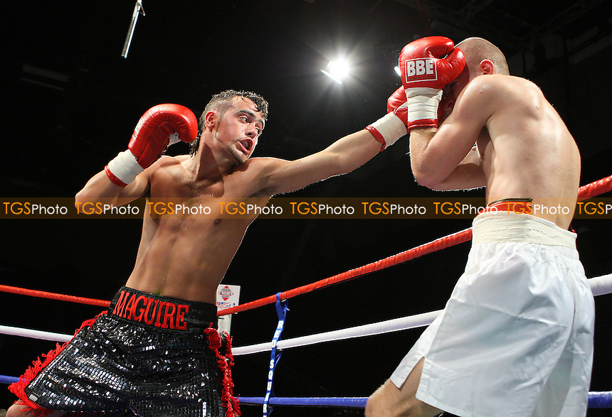 Michael Maguire (black/red shorts) defeats Pavels Senkovs in a Super-Bantamweight boxing contest at the Brentwood Centre, promoted by Frank Maloney - 22/01/10 - MANDATORY CREDIT: Gavin Ellis/TGSPHOTO - Self billing applies where appropriate - Tel: 0845 094 6026