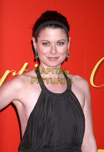 DEBRA MESSING .At the Cartier's Celebration of the Cartier Charity Love Bracelet at the The Cartier Mansion, New York, NY, USA..June 7th, 2007 .half length brown halterneck green earrings alice band headband .CAP/IW.©Ian Wilson/Capital Pictures