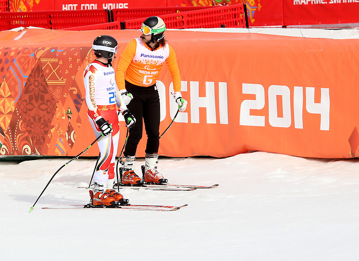 Sochi, Russia,08/03/2014. Canadian skier Mac Marcoux and guide Robin Femy ski to a bronze medal in the mens Downhill, Visually impared during the 2014 Paralympic Games.Photo(Scott Grant/Canadian Paralympic Committee