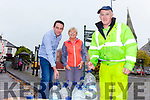 Cllr. Jimmy Moloney and Johnny McGrath leading a hand to Margaret McAuliffe from Listowel as she collects water for her home on Monday morning while waiting for the mains water to be fixed.