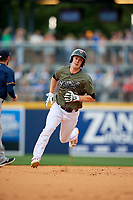 Nashville Sounds designated hitter Mark Canha (16) runs the bases during game against the New Orleans Baby Cakes on April 30, 2017 at First Tennessee Park in Nashville, Tennessee.  The game was postponed due to inclement weather in the fourth inning.  (Mike Janes/Four Seam Images)