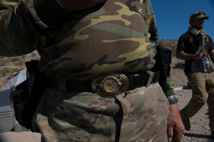 Belt buckle adorned with a silver dollar on the belt of Korean War veteran Robert Deihl who came to join the militia camp &quot;Liberty&quot; established near Cliven Bundy ranch in Bunkerville, Nevada. <br />
