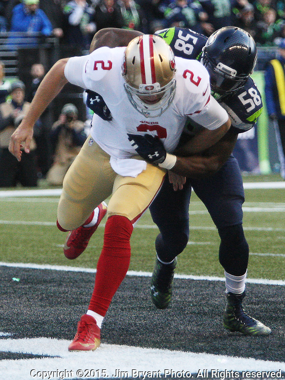 San Francisco 49ers quarterback Blaine Gabbert (2) is hit after passing by Seattle Seahawks linebacker Kevin Pierre-Louis (58)  at CenturyLink Field in Seattle, Washington on November 22, 2015.  The Seahawks beat the 49ers 29-13.   ©2015. Jim Bryant Photo. All RIghts Reserved.
