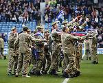Members of HM armed forces on the Ibrox pitch at half-time