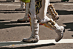 White boots with bells on them, worn by men dancing and representing Bolivia in the Hispanic Parade in New York City