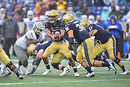 Annapolis, MD - September 8, 2018: Navy Midshipmen quarterback Malcolm Perry (10) hands the ball off to Navy Midshipmen fullback Anthony Gargiulo (38) during game between Memphis and Navy at  Navy-Marine Corps Memorial Stadium in Annapolis, MD. (Photo by Phillip Peters/Media Images International)