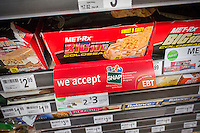 A sign on a sales rack of an energy bar in a 7-Eleven in New York on Sunday, July 27, 2014 promotes the convenience store's acceptance of  the SNAP (Supplemental Nutrition Assistance Program) formerly known as EBT. (© Richard B. Levine)