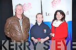 RECITATION: Tadgh O Siohrú, winner of the Scór Na bPaistí, 2013 in Recitation, in the Tinteán Thatre, Ballybunion on Sunday, with hios parents Cian and Chris O'Siovhrú.
