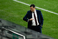 30th July 2020; Bankwest Stadium, Parramatta, New South Wales, Australia; A League Football, Adelaide United versus Perth Glory; Carl Veart coach of Adelaide United checks how long is left of the game as his side lead 5-3