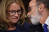 Christine Blasey Ford (L), the woman accusing Supreme Court nominee Brett Kavanaugh of sexually assaulting her at a party 36 years ago, confers with her attorney Michael R Bromwich (R) as she testifies before the US Senate Judiciary Committee on Capitol Hill in Washington, DC, September 27, 2018.  / POOL / SAUL LOEB