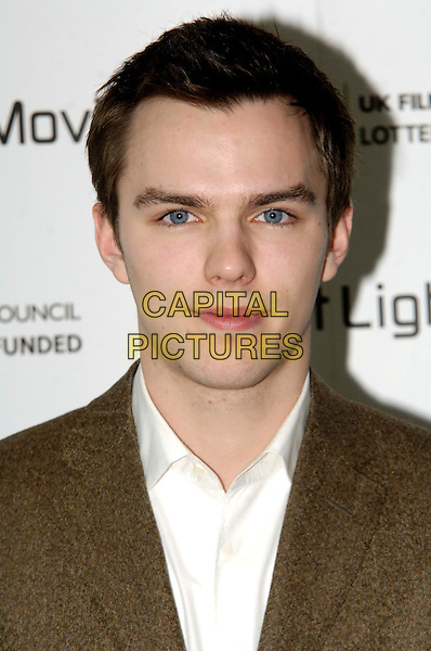 NICHOLAS HOULT .Inside Arrivals - The First Light Film Awards 2010, Odeon Leicester Square, .London, England, UK,.2nd March 2010..portrait headshot brown white shirt .CAP/CJ.©Chris Joseph/Capital Pictures.