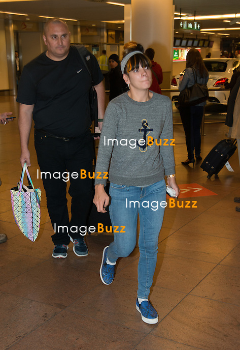 EXCLUSIVE - Lily Allen arrived from Hamburg , Germany, at the Brussels airport in Belgium around noon time, before heading to the 'Videohouse', for a private concert organised by NRJ Radio station, in front of only two hundred people.<br /> Following the concert, Lily Allen went to downtown Brussels to the famous belgian restaurant ' La Taverne du Passage'.<br /> May 27, 2014.<br /> Pic : Lily Allen at the Brussels airport