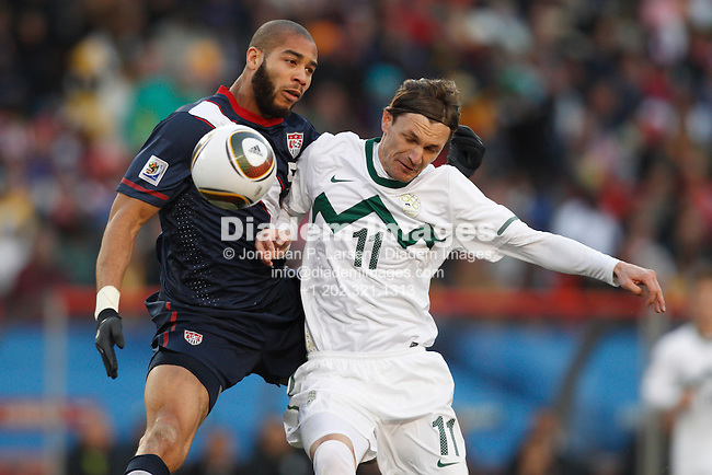 JOHANNESBURG - JUNE 18:  Oguchi Onyewu of the United States (l) and Milivoje Novakovic of Slovenia (r) collide for the ball during a 2010 FIFA World Cup soccer match June 18, 2010 in Johannesburg, South Africa.  NO mobile use.  Editorial ONLY.  (Photograph by Jonathan P. Larsen)